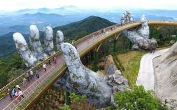 The hands supporting the gold bridge, to keep the sky in Da Nang – Vietnam